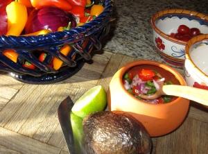Just a few ingredients turn Pico de Gallo into a simple guacamole.